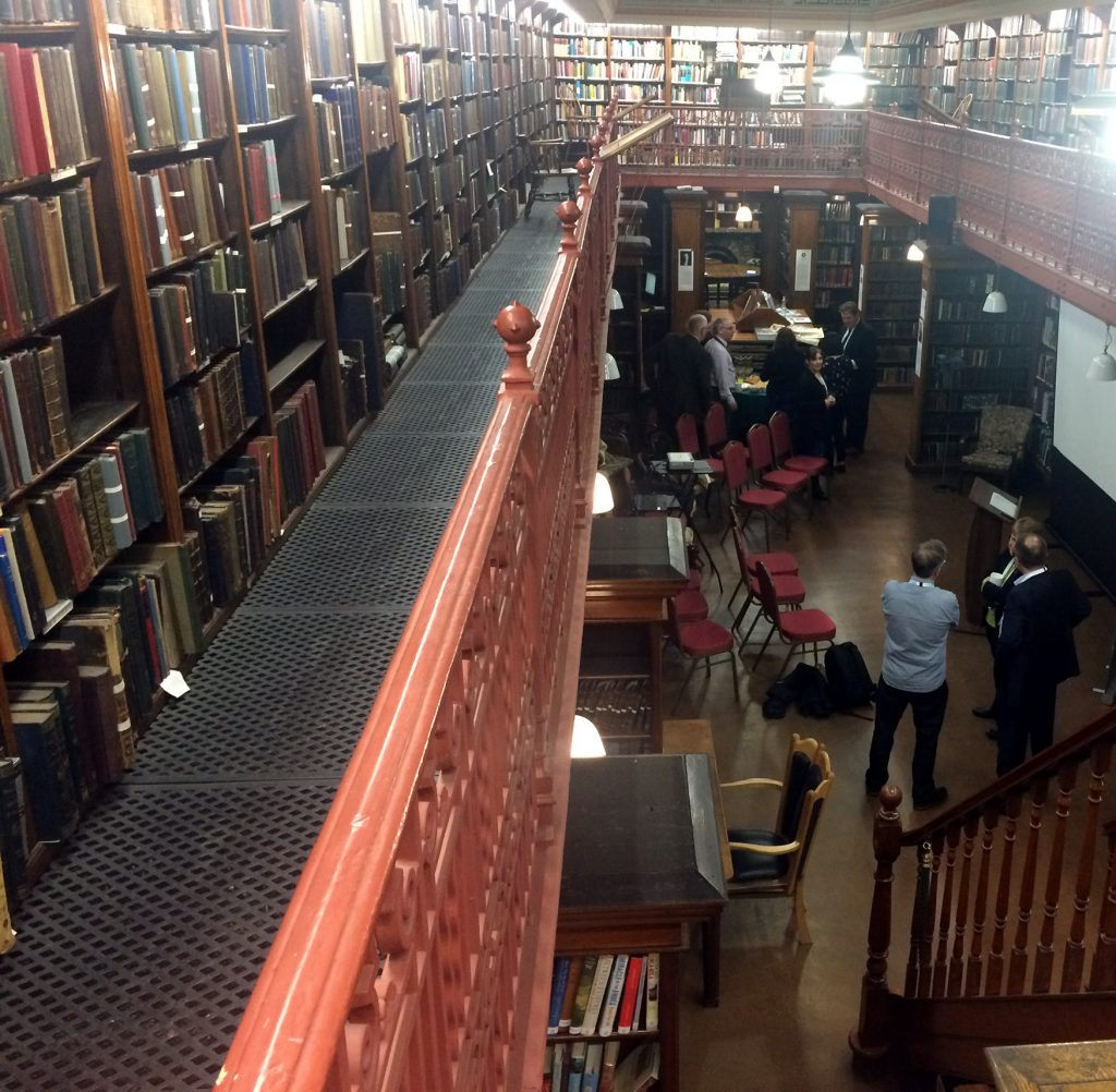 Photo: interior of Leeds Library taken from the upper, mezzanine level.